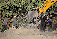 Pictured: Forensic archaeologists assisted by a digger work at the second site in Kos, Greece. Tuesday 11 October 2016<br />