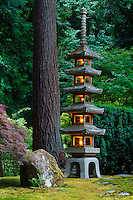 The 18-foot Pagoda Tower stone lantern is lit in the Portland Japanese Garden.  The five stories of the Pagoda are symbolic representing earth, water, fire, wind and sky.  This lantern was given to Portland from its Sister City, Sapporo, Japan.