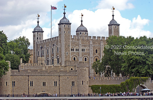 London, GBR - August 7, 2005 -- The Tower of London viewed from a ferry in the Thames River on August 7, 2005.  Construction of the tower was begun during the reign of William the Conquerer from 1066 - 1087.  This view also shows the Traitors' Gate at the lower left of the frame.  This gate was built between 1275 and 1279 to provide an entrance to the tower from the Thames River.  It became known as the Traitors' Gate due to the large number of prisoners accused of treason passed through it to be imprisoned in  the Tower.  Some, such as Queen Anne Boelyn and Sir Thomas More, entered the prison and were later executed..Credit: Ron Sachs / CNP