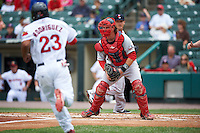 Pawtucket Red Sox catcher Matt Spring (47) waits for a throw as Reynaldo Rodriguez (23) runs towards home plate to score a run during a game against the Rochester Red Wings on July 1, 2015 at Frontier Field in Rochester, New York.  Rochester defeated Pawtucket 8-4.  (Mike Janes/Four Seam Images)