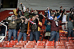 The small band of around 60 visiting supporters react with delight as their team scores the only goal of the game at the Britannia Stadium, Stoke-on-Trent, during the UEFA Europa League last 32 first leg between Stoke City and visitors Valencia. The match ended in a 1-0 victory from the visitors from Spain. Mehmet Topal scored the only goal in the first half in a match watched by a crowd of 24,185.