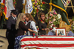 September 20, 2004 Angels Camp, California --Tuolumne Fire –- The memorial service for fallen firefighter Eva Marie Schicke was held at the Calaveras County Fairgrounds.  The Tuolumne Fire was a small very fast-moving fire that started around noon on September 12, 2004 near Lumsden Bridge at the bottom of the Tuolumne River.  The fire moved rapidly up the 80-plus-degree slope catching Cal Fire Helitack firefighters, tragically killing firefighter Eva Marie Schicke and injuring five others.