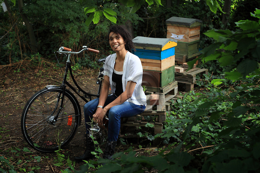 """Joe Palmer, 33 years old, is a musician by training and started beekeeping three years ago after meeting beekeepers during a trip to Albania for a film shoot for National Geographic. She loves bees, their harmony, the complexity of their society... """"their landings on the flight board and their capacity to sting when I start to think about new shoes, chocolate or anything that distances me from the present moment."""" Here she is in the apiary in St Mary's Secret Garden, a community garden in Hackney. http://www.stmaryssecretgarden.org.uk"""
