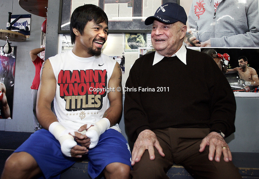 "April 21, 2011, Hollywood,Ca. --- ""RICKLES THROWS PUNCHLINES AT PACQUIAO"" --- Legendary comedian Don Rickles(R), affectionately known as ""The Merchant of Venom"" and ""Mr. Warmth"" stops by the Wildcard Boxing Club in Hollywood Thursday to share a laugh with superstar Manny Pacquiao(L). Pacquiao is in preparation for his upcoming World Welterweight mega fight against ""Sugar"" Shane Mosley on Saturday, May 7 at the MGM Grand in Las Vegas. Pacquiao vs Mosley is promoted by Top Rank in association with MP Promotions,Sugar Shane Mosley Promotions,Tecate and MGM Grand.  The Pacquiao vs Mosley telecast will be available live on SHOWTIME Pay Per View.  --- Photo Credit : Chris Farina - Top Rank  (no other credit allowed)  copyright 2011"