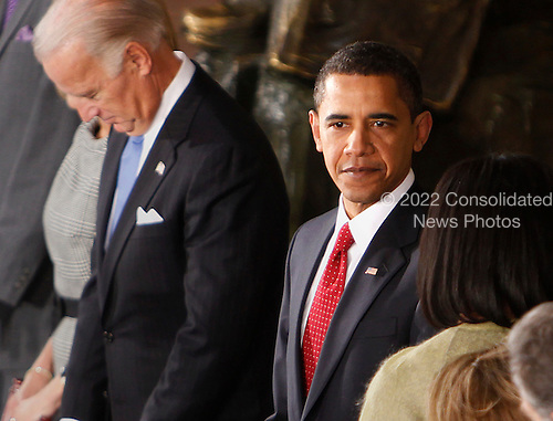 Washington, DC - January 20, 2009 -- United States President Barack Obama and Vice-President Joseph Biden, left, at a luncheon held in their honor at Statuary Hall in the U.S. Capitol  in Washington, Tuesday, January 20, 2009. .Credit: Lawrence Jackson - Pool via CNP