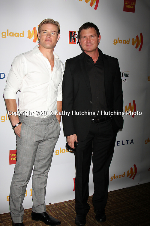 LOS ANGELES - APR 21:  Trevor Donovan, Kevin Williamson. arrives at the 23rd GLAAD Media Awards at Westin Bonaventure Hotel on April 21, 2012 in Los Angeles, CA