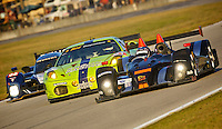 Three classes of cars race three-wide during  the 12 Hours of Sebring, Sebring, FL, MArch 20, 2010.  (Photo by Brian Cleary/www.bcpix.com)