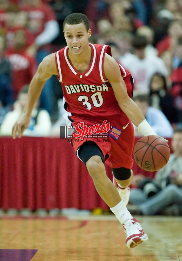 Davidson's Stephen Curry (30) pushes the ball up court during second half action versus the North Carolina State Wolfpack at the RBC Center in Raleigh, NC, Friday, December 21, 2007.  The Wolfpack defeated the Wildcats 66-65.