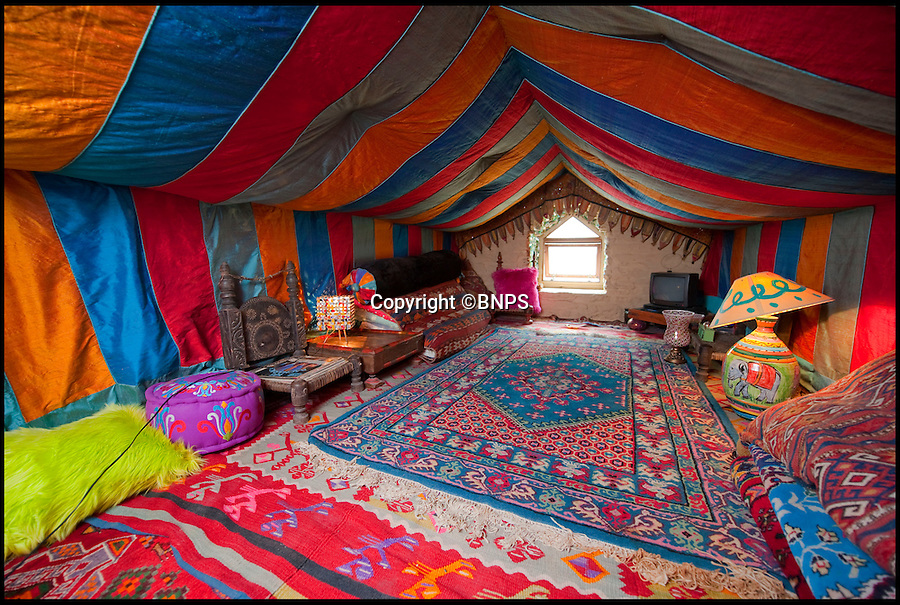 BNPS.co.uk (01202 558833)<br /> Pic: PhilYeomans/BNPS<br /> <br /> Loft looks like something from Arabian Nights.<br /> <br /> Britain's wackiest property has come on the market...And the estate agents mantra of paint everything magnolia has definately not been applied.<br /> <br /> It may look like an idyllic cottage in the Forest of Dean from the outside but ceramic artist Mary Rose Young's unique taste has transformed the interior into what looks like something from Alice in Wonderland.<br /> <br /> The three-bedroomed house is decorated from head to toe in crazy colours, clashing patterns, and enormous murals,<br /> each room is covered in the garish designs, including the bathroom, where even the sink and toilet have been adorned in bright tiles.<br /> <br /> Estate agents Bidmead Cook now have the tricky task of showing prospective punters round the &pound;500,000 property.