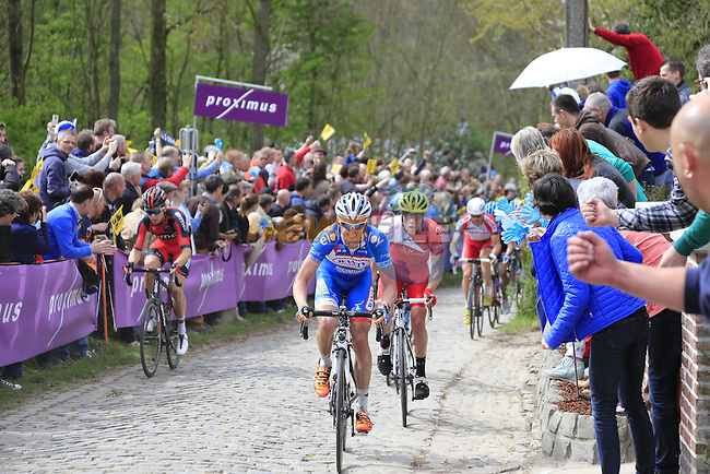 The breakaway group, led by James Vanlandschoot (BEL)Wanty-Groupe Robert, climb the Molenberg during the 2014 Tour of Flanders, Belgium.<br /> Picture: Eoin Clarke www.newsfile.ie