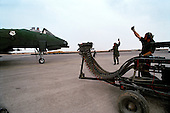 Al Batin, Saudi Arabia<br /> February 2, 1991<br /> <br /> American A-10 planes loaded with 500 pound bombs to be used on targets in Iraq and Kuwait are readied for take-off at King Khalid Military City -KKMC or Emerald City.