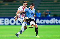ARMENIA, COLOMBIA - JANUARY 19: Uruguay's Juan Ramirez fights for the ball against Paraguay's Saul Salcedo during their CONMEBOL Pre-Olympic soccer game at Centenario Stadium on January 19, 2020 in Armenia, Colombia. (Photo by Daniel Munoz/VIEW press/Getty Images)