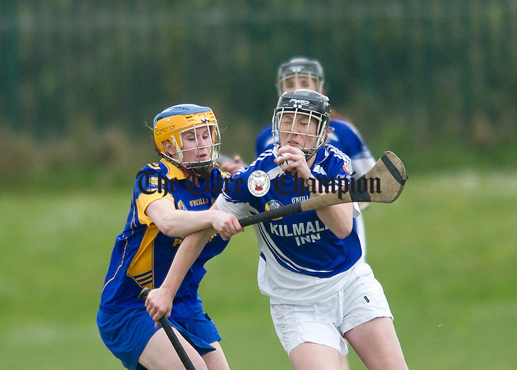 Kilmaley's Eimear Considine under pressure from Jenny Kelly. Photograph by Declan Monaghan