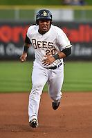 Luis Martinez (20) of the Salt Lake Bees hustles towards third base against the Albuquerque Isotopes at Smith's Ballpark on April 21, 2014 in Salt Lake City, Utah.  (Stephen Smith/Four Seam Images)