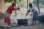 Women cook food for students in the Catholic primary school in Kauda, a village in the Nuba Mountains of Sudan. The area is controlled by the Sudan People's Liberation Movement-North, and frequently attacked by the military of Sudan. The church has sponsored schools and health care facilities throughout the war-torn region.