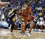 SIOUX FALLS, SD - MARCH 8: Tyson Ward #24 of the North Dakota State Bison drives to the basket past Deondre Burns #2 of the Oral Roberts Golden Eagles at the 2020 Summit League Basketball Championship in Sioux Falls, SD. (Photo by Dave Eggen/Inertia)