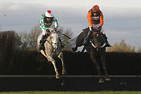 Race winner Elenika ridden by Ruby Walsh (L) in jumping action alongside Rajdhani Express ridden by Mr S Waley-Cohen during the Tom Jones Memorial HTJ Centre Ltd