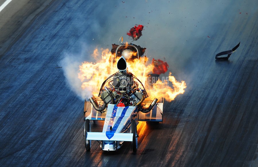 """Mar. 8, 2008; Bakersfield, CA, USA; Nostalgia top fuel dragster driver Mike McLennan suffers a massive fire during qualifying for the 50th annual March Meet at the Auto Club Famoso Raceway.  McLennan was engulfed in a giant fireball as the engine exploded and raw fuel fed the fire. """"It was definitely interesting,"""" said McLennan, 47. """"It went from what felt like a perfect run to orange and red. It didn't give any warning, it just went.""""  Mandatory Credit: Mark J. Rebilas"""