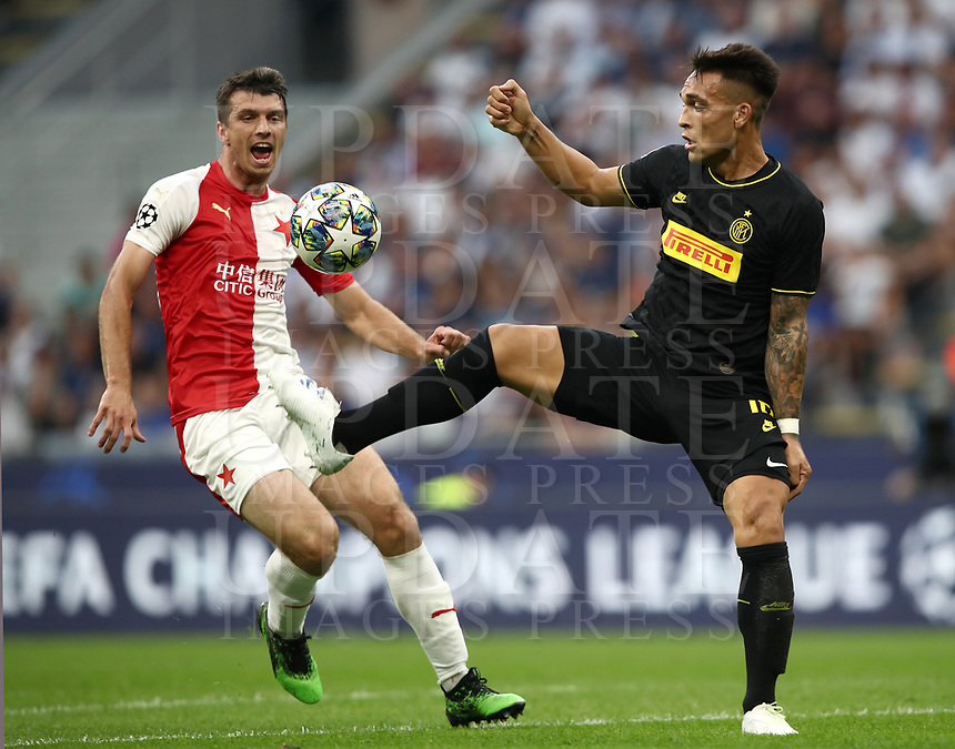 Football Soccer: UEFA Champions League -Group Stage- Group F Internazionale Milano vs  SK Slavia Praha, Giuseppe Meazza stadium, September 17, 2019.<br /> Inter's Lautaro Martinez (r) in action with Slavia Praha's Ondrej Kudela (l) during the Uefa Champions League football match between Internazionale Milano and Slavia Praha at Giuseppe Meazza (San Siro) stadium, September 17, 2019.<br /> UPDATE IMAGES PRESS/Isabella Bonotto