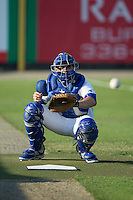Burlington Royals catcher Colton Frabasilio (18) warms up the pitcher in the bullpen prior to the game against the Bluefield Blue Jays at Burlington Athletic Park on June 29, 2015 in Burlington, North Carolina.  The Royals defeated the Blue Jays 4-1. (Brian Westerholt/Four Seam Images)