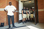 Wake Forest Demon Deacons graduate assistant Bryant Gross-Armiento and players Dayton Diemel (52), Zach Murphy (88), and Noah Turner (61) wait to take the field for warm-ups prior to the game against the Notre Dame Fighting Irish at BB&T Field on September 22, 2018 in Winston-Salem, North Carolina. The Fighting Irish defeated the Demon Deacons 56-27. (Brian Westerholt/Sports On Film)