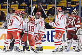 Garrett Noonan (BU - 13), Sahir Gill (BU - 28), Wade Megan (BU - 18), Cason Hohmann (BU - 23) and Patrick MacGregor (BU - 4) celebrate Megan's goal. - The Boston University Terriers defeated the Harvard University Crimson 3-1 in the opening round of the 2012 Beanpot on Monday, February 6, 2012, at TD Garden in Boston, Massachusetts.