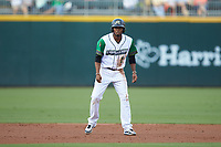 Alcides Escobar (2) of the Caballeros de Charlotte takes his lead off of second base against the Buffalo Bisons at BB&T BallPark on July 23, 2019 in Charlotte, North Carolina. The Bisons defeated the Caballeros 8-1. (Brian Westerholt/Four Seam Images)