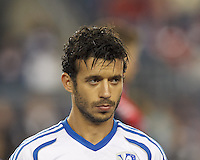 Montreal Impact midfielder Felipe Martins (7). In a Major League Soccer (MLS) match, Montreal Impact (white/blue) defeated the New England Revolution (dark blue), 4-2, at Gillette Stadium on September 8, 2013.