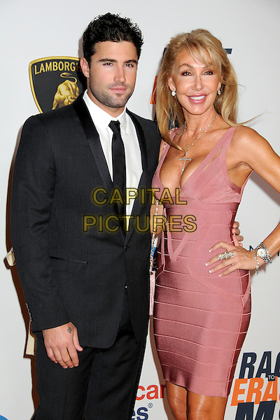 BRODY JENNER & LINDA THOMPSON.17th Annual Race To Erase MS held at the Hyatt Regency Century Plaza Hotel, Century City, California, USA..May 7th, 2010.half length black tie grey gray suit trainers mother son mom mum family beige pink herve leger bandage body con dress hand on hip cleavage .CAP/ADM/BP.©Byron Purvis/AdMedia/Capital Pictures.