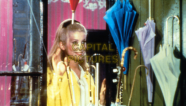 CATHERINE DENEUVE.in Umbrellas of Cherbourg (Les Parapluies de Cherbourg).*Editorial Use Only*.www.capitalpictures.com.sales@capitalpictures.com.Supplied by Capital Pictures.