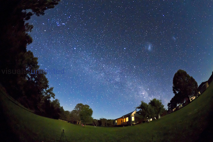 The southern Milky Way seen from Australia looking southeast toward Orion and the Milky Way rising with Magellanic Clouds high in the south at the right.