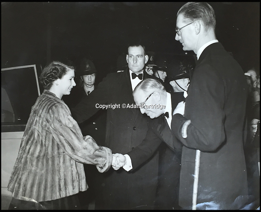 BNPS.co.uk (01202 558833)<br /> Pic: AdamPartridge/BNPS<br /> <br /> Alexander Usher pictured to the right of the Queen.<br /> <br /> A fascinating photo archive that documents the dedication of one of the Queen's bodyguards has come to light 70 years later.<br /> <br /> Police Inspector Alexander Usher was appointed 'No.1 Shadow' to Princess Elizabeth in 1944, when she was aged 18 and 'heir presumptive' to the throne behind her father King George VI.<br /> <br /> Mr Usher served alongside her until 1951, by which time she had married Prince Philip. He even went on their honeymoon.<br /> <br /> The album of photo which he features in is now being sold by Adam Partridge auctioneers.