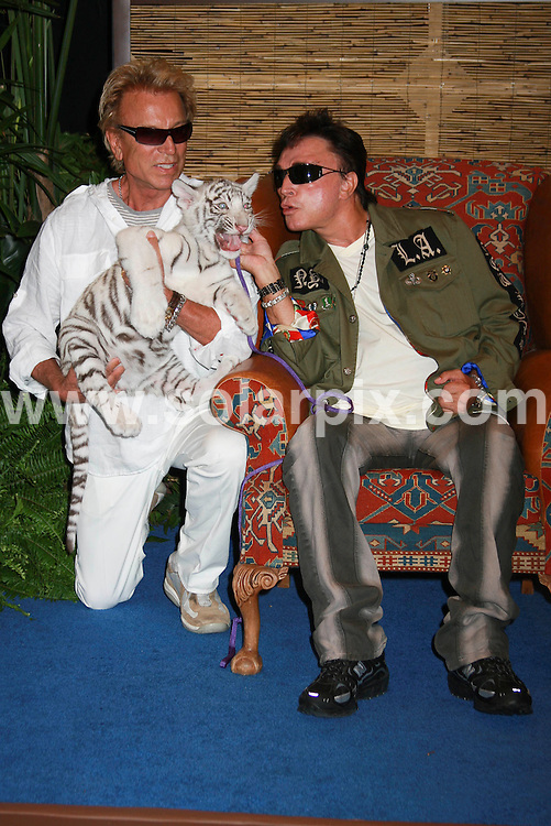 **ALL ROUND PICTURES FROM SOLARPIX.COM**.**SYNDICATION RIGHTS FOR UK, SPAIN, PORTUGAL, AUSTRALIA, S.AFRICA & DUBAI (U.A.E) ONLY**.The world famous Tiger trainers Siegfried and Roy Reveal Winning Names at the Tiger Cub Naming at the Mirage Hotel Casino in Las Vegas Nevada in the USA. .This pic:Siegfried and Roy..JOB REF:6903-PHZ/PRN        DATE:23_07_08 .**MUST CREDIT SOLARPIX.COM OR DOUBLE FEE WILL BE CHARGED* *UNDER NO CIRCUMSTANCES IS THIS IMAGE TO BE REPRODUCED FOR ANY ONLINE EDITION WITHOUT PRIOR PERMISSION*