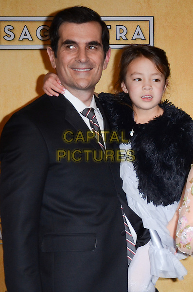 Ty Burrell, Aubrey Anderson-Emmons.Pressroom at the 19th Annual Screen Actors Guild Awards held at The Shrine Auditorium, Los Angeles, California, USA..27th January 2013.SAG SAGs half length black dress suit fur cape.CAP/ADM/TW.©Tonya Wise/AdMedia/Capital Pictures.