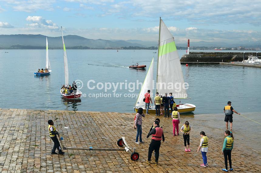 Sailing lessons, teenagers, youths, sailing dinghies, marina, Bay of Santander, Bahia de Santander, Spain, 8th May 2015, 201505083827