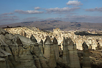 Fairy chimneys in Love Valley or Bagildere Vadisi, in Goreme National Park, between Goreme and Uchisar, in Nevsehir province, Cappadocia, Central Anatolia, Turkey. The rock formations here were made by erosion of the soft volcanic tuff created by ash from volcanic eruptions millions of years ago, with harder basalt caps topping the chimneys. The area also contains cave dwellings, underground towns and churches, carved out of the rock in the Byzantine period. This area forms part of the Goreme National Park and the Rock Sites of Cappadocia UNESCO World Heritage Site. Picture by Manuel Cohen
