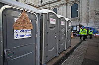 "London, 16/10/2011. Second day of the peaceful Occupation outside St Paul's Cathedral. In the early morning representatives of St Paul's asked police officers to leave the steps of the Cathedral and stop any attempt to evict the occupants. The tents are now numbered at around two hundred. The protesters have built a kitchen, and now dedicate their time to political meetings, discussions, creation of a library, placards and posters to show their messages: ""We are the 99%""."