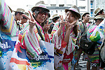 "Tokyo, Japan - Customers pose for cameras outside the Desigual store in Tokyo's Harajuku fashion district. A fashion chain called ""Seminaked Party by Desigual"" offers the first 100 customers (wearing swimsuit) free clothing items at the grand opening in Tokyo, Japan, June 22, 2013. More than 4,000 people attend the Seminaked Party around the world. (Photo by Rodrigo Reyes Marin/AFLO)"