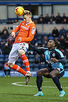 Joe Pigott of Luton Town and Aaron Pierre of Wycombe Wanderers during the Sky Bet League 2 match between Wycombe Wanderers and Luton Town at Adams Park, High Wycombe, England on 6 February 2016. Photo by David Horn.