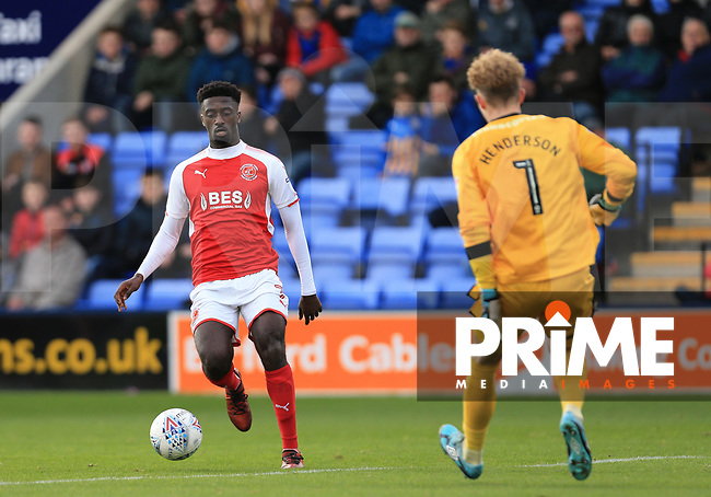 Jordy Hiwula of Fleetwood Town takes on Dean Henderson of Shrewsbury Town during the Sky Bet League 1 match between Shrewsbury Town and Fleetwood Town at Greenhous Meadow, Shrewsbury, England on 21 October 2017. Photo by Leila Coker / PRiME Media Images.