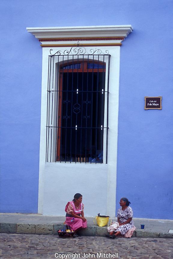 Indigenous women chatting on the street in Oaxaca