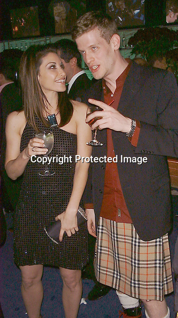 Gina Gershon &amp; Damien Loeb<br />2000 Vanity Fair Post Oscar Party<br />Morton's Restaurant<br />Los Angeles, California, USA<br />March 26, 2000<br />Photo by Celebrityvibe.com