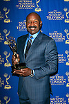 BEVERLY HILLS - JUN 22: Rushion McDonald, with the award for Outstanding Game Show Host 'Steve Harvey' at The 41st Annual Daytime Emmy Awards Press Room at The Beverly Hilton Hotel on June 22, 2014 in Beverly Hills, California