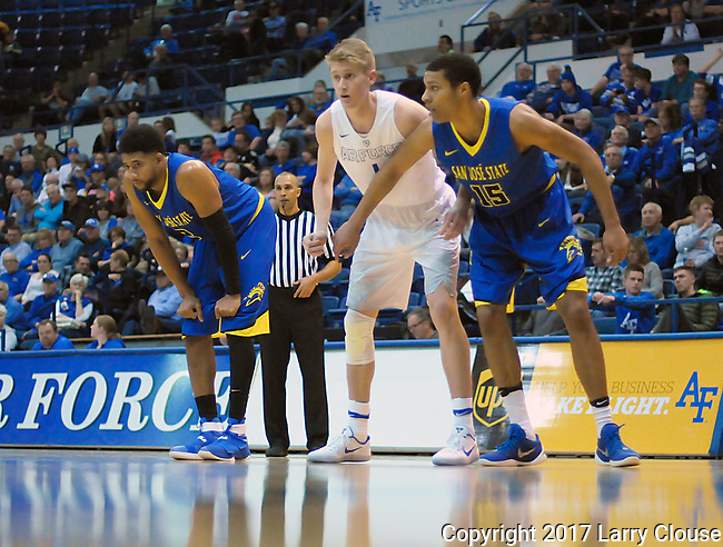 January 14, 2017:  San Jose State guard, Brandon Clarke #15, and Falcon forward, Dane Norman #1, during the NCAA basketball game between the San Jose State Spartans and the Air Force Academy Falcons, Clune Arena, U.S. Air Force Academy, Colorado Springs, Colorado.  San Jose State defeats Air Force 89-85.