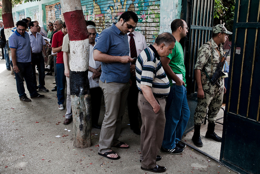 Egyptian men line up at a polling station on the first day of voting in the Egyptian presidential elections, in the Cairo suburb of Dokki, Egypt, May 23, 2012. Photo: ED GILES.