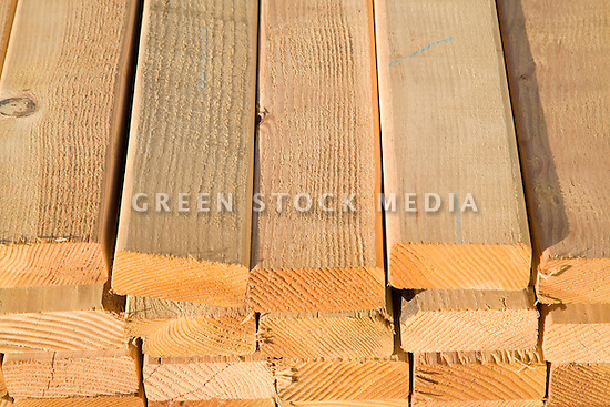 A high angle view of stacks of two by four lumber ready for a construction project.