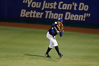 21 September 2012: Marc Ramirez catches a fly ball during France vs South Africa tie game 2-2, rain delayed at the end of the 9th inning at 1 AM, during the 2012 World Baseball Classic Qualifier round, in Jupiter, Florida, USA. Game to resume 22 September 2012 at noon.