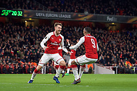 Aaron Ramsey of Arsenal celebrates his goal with Alexandre Lacazette of Arsenal during the UEFA Europa League QF 1st leg match between Arsenal and CSKA Moscow  at the Emirates Stadium, London, England on 5 April 2018. Photo by Andrew Aleksiejczuk / PRiME Media Images.