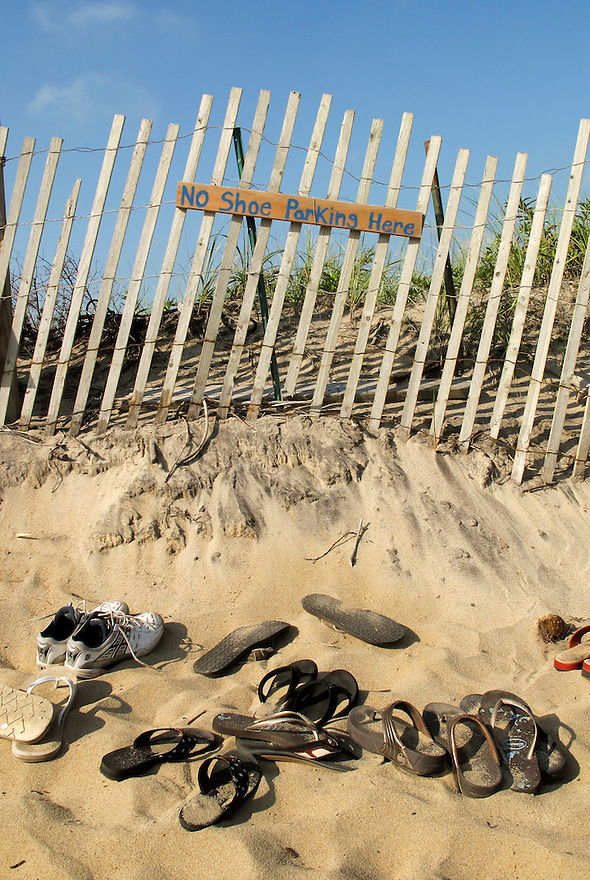 Shoes and flip flops sit at Lucy Vincent Beach, a popular town beach in Chilmark, on Martha's Vineyard. .