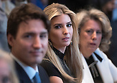 Ivanka Trump participates in a roundtable with Canadian Prime Minister Justin Trudeau (L) and President Donald Trump on the advancement of women entrepreneurs and business leaders, at the White House in Washington, D.C. on February 13, 2017. <br /> Credit: Kevin Dietsch / Pool via CNP